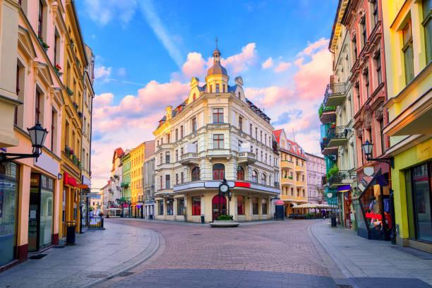 central pedestrian street in torun, poland - poland stock photos and pictures