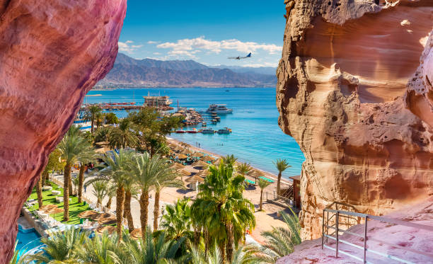Central public beach and marina in Eilat - famous resort and recreation city in Israel stock photo