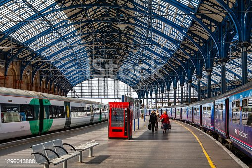 Brighton, East Sussex, England - June 17, 2013: Passengers walking towards trains on Brighton Railway Station