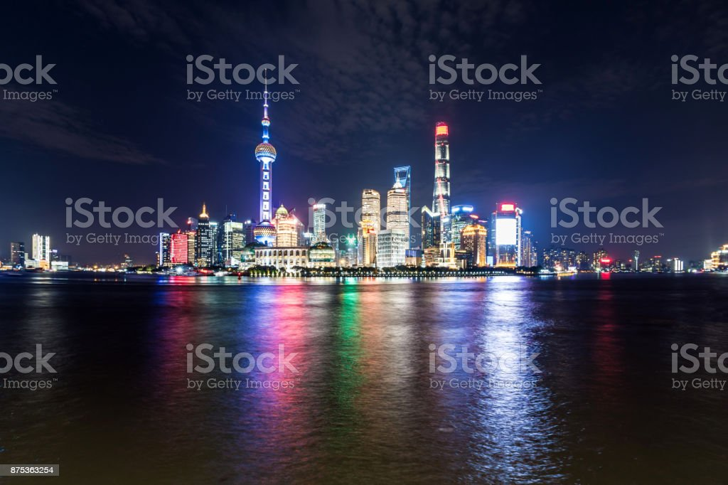 Central Shanghai Skyline at night with reflection in river stock photo