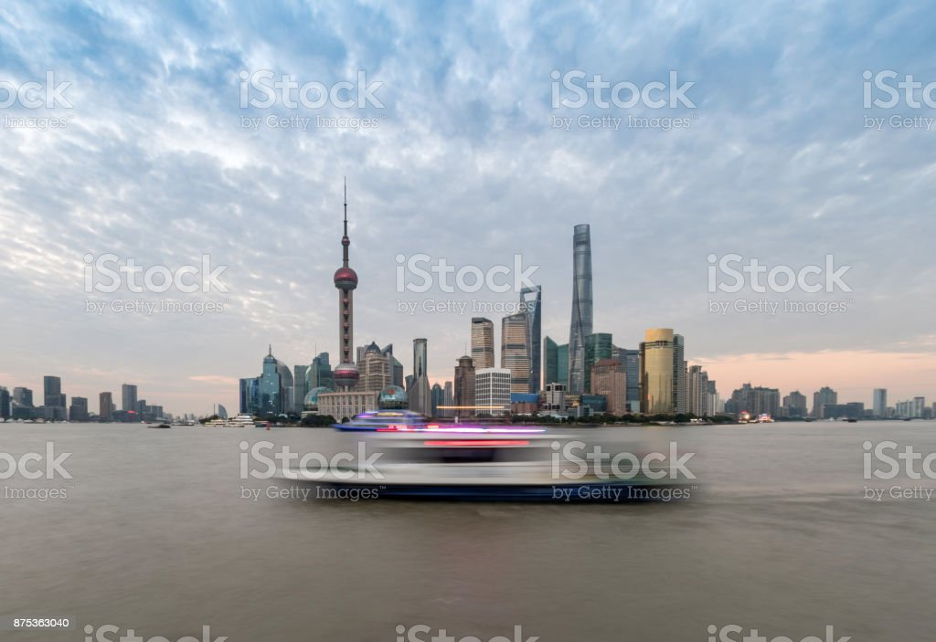 Central Shanghai Skyline with boat passing on river stock photo