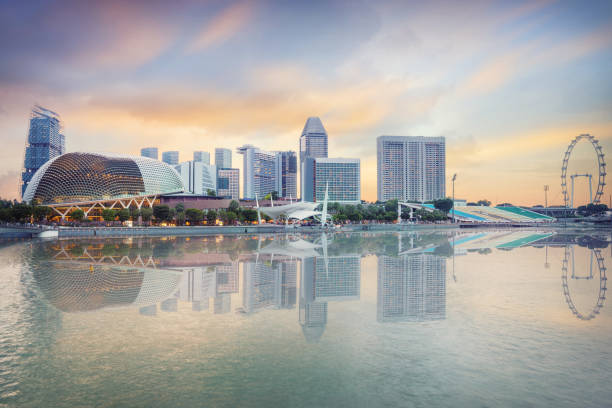 central singapore skyline at dusk - marina bay sands stock photos and pictures