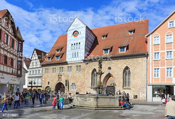 Reutlingen, Germany - May 11, 2013: The central square Marktplatz (market square) in Reutlingen, Baden-Wurttemberg, Germany. In the front the Fountain of Maximilian in memoriam of emperor Maximilian II. Several people on the square which is a pedestrian zone.