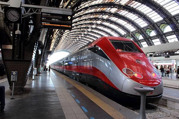 Central train station Milan, Italy. FrecciaRossa train stock photo