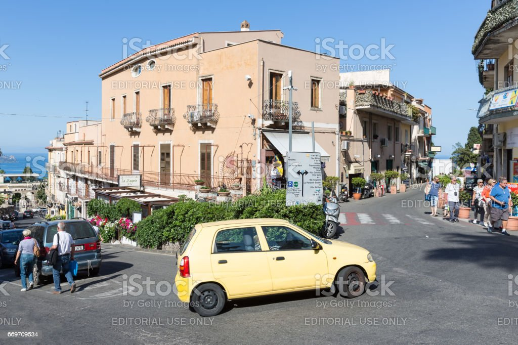 Centre with tourits and cars of Taormina at the island Sicily stock photo
