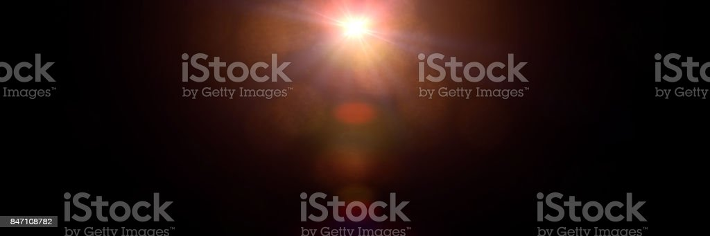 centred lens flare effect with bokeh, overlay texture banner in front of a black background stock photo