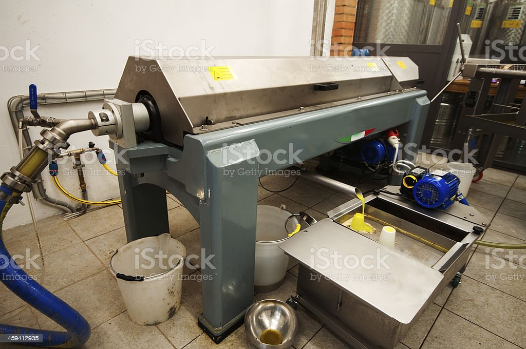 Centrifuge or decanter for extracting extra virgin olive oil stock photo