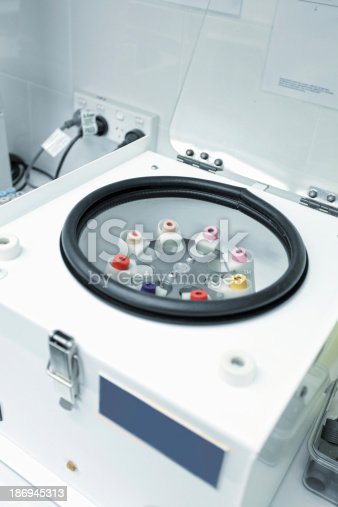 istock Centrifuge with pathology blood tubes for spinning 186945313