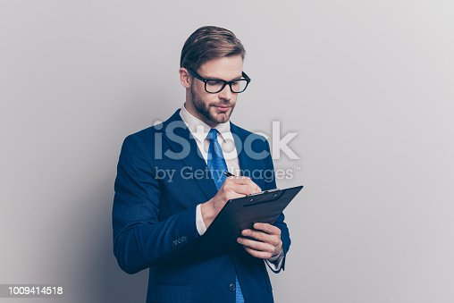 istock Ceo message conference idea decision plan executive leader people person concept. Portrait of confident serious smart inspector making notes to the clipboard isolated on gray background copy-space 1009414518