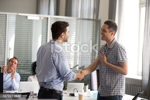 istock Ceo motivating rewarding male employee shaking hand congratulating with promotion 1070271640