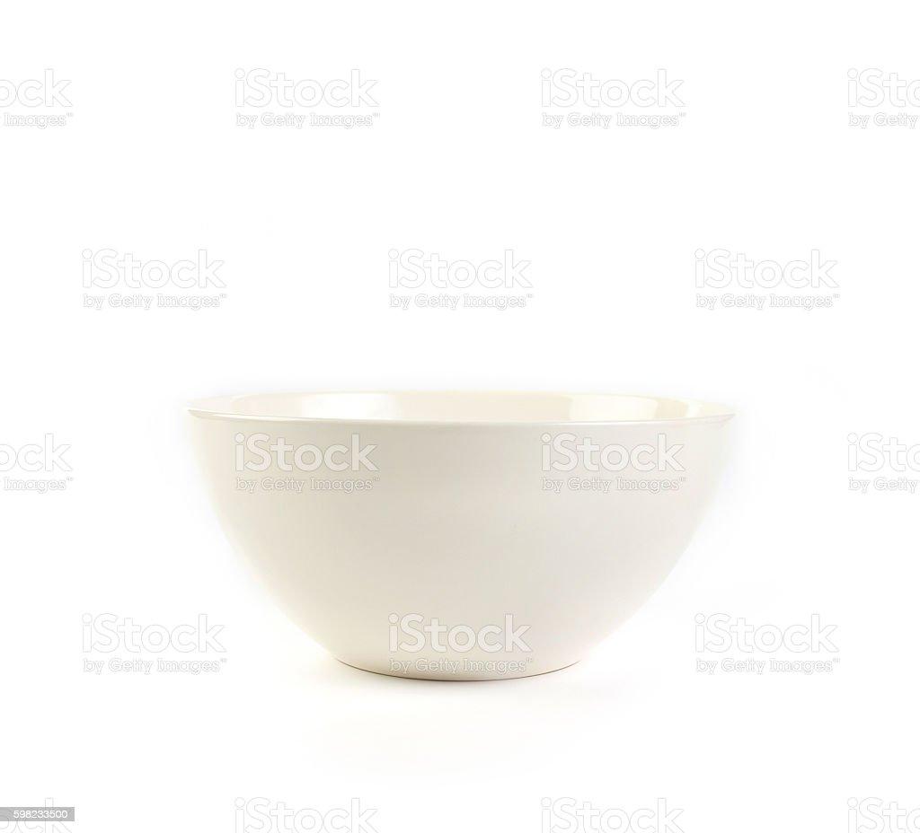 Tigela sobre fundo branco de cerâmica foto royalty-free