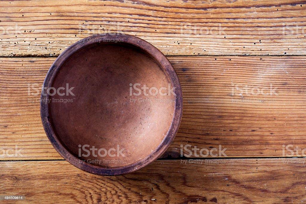 Ceramic bowl on wooden background stock photo