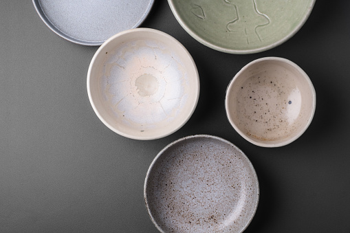 ceramic bowls on grey background