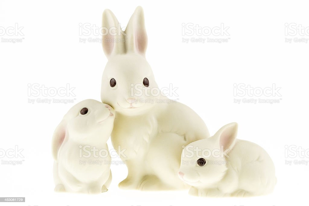 Ceramic bunny family isolated on a white background. stock photo