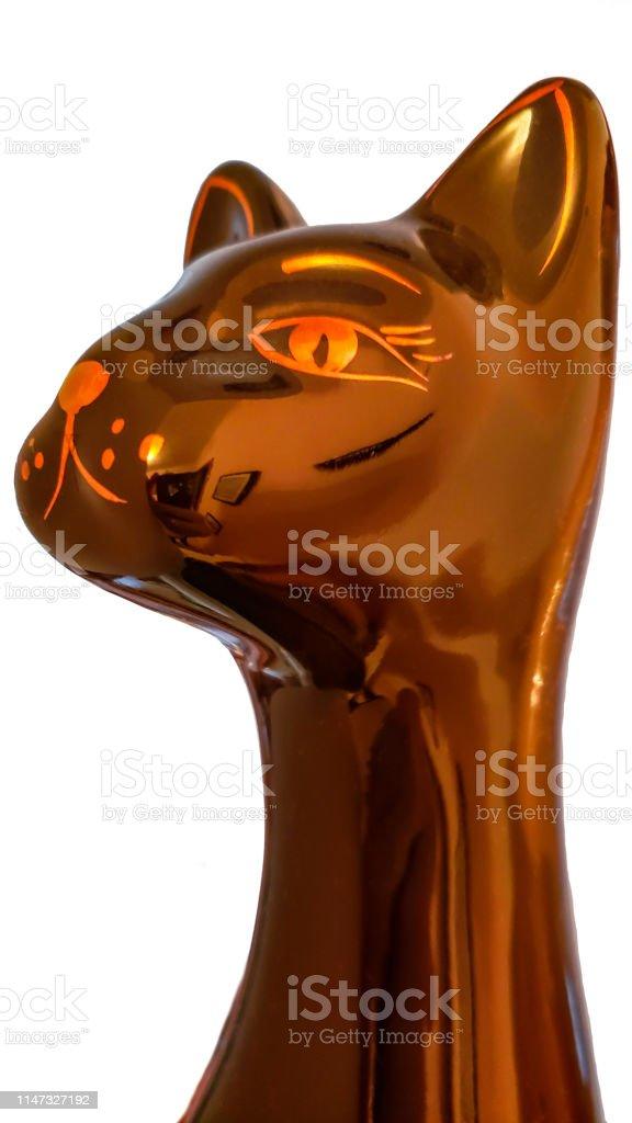 ceramic cat figurine isolated on white background stock photo
