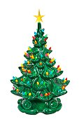 Green ceramic Christmas Tree with colored lights isolated on a white background.   The tree is decorated various colorful lights with a star on top.  The ceramic tree is covered with a glossy fired glaze.   Makes a good Christmas or religious holiday decorations.