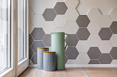 Close-up of ceramic containers, jug and hexagon tiles in kitchen