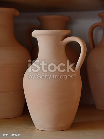 istock Ceramic craft jug made by a Potter, against the background of other clay products 1221012607