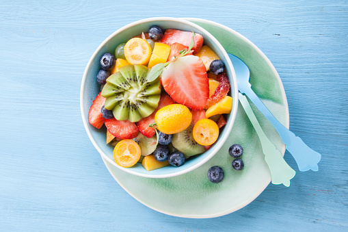 Ceramic cup with fresh fruit salad