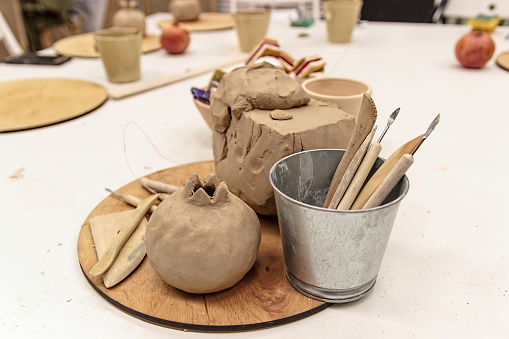 Ceramic dishes in working process. Creating ceramic.