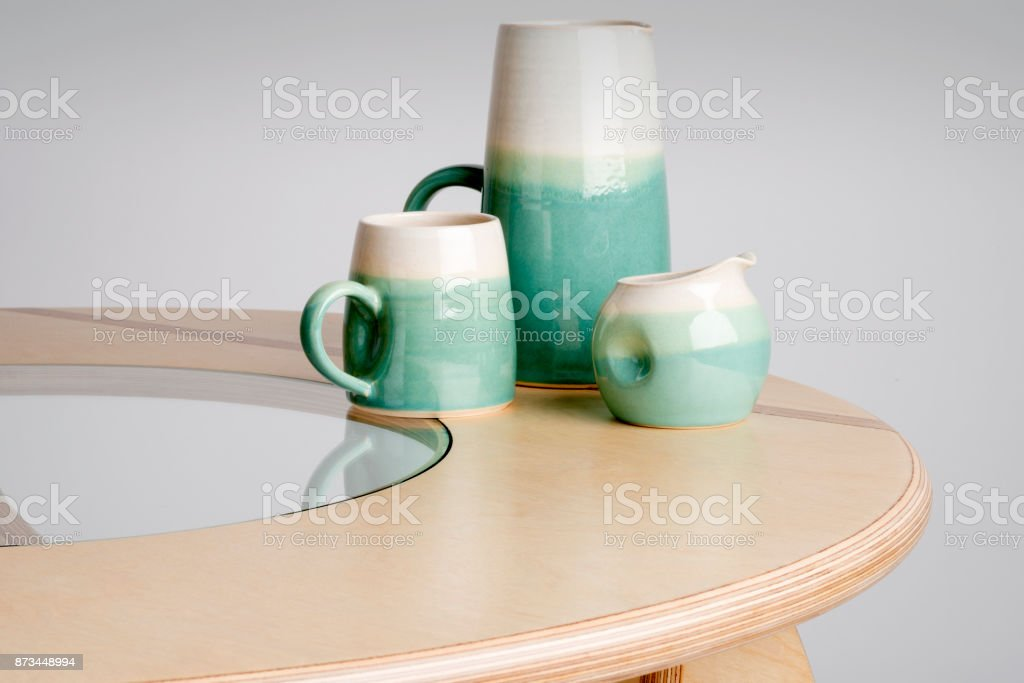 Ceramic Drinking Set on a Round Table Top stock photo
