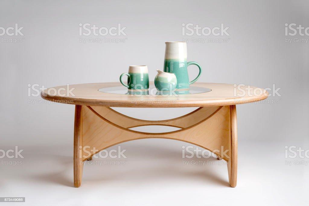 Ceramic Drinking Set on Natural Wood Designer Round Table stock photo