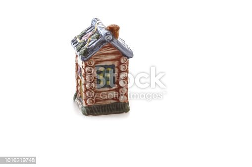 Ceramic figurine for spices in the form of house-hut isolated on white background