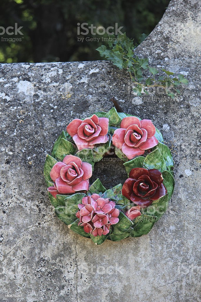 Ceramic flowers funeral wreath stock photo