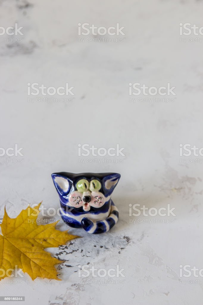 Ceramic handmade cat on a white background stock photo