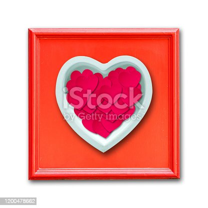 istock Ceramic heart in a red frame. Isolated. Happy Valentine's day background. 1200478662