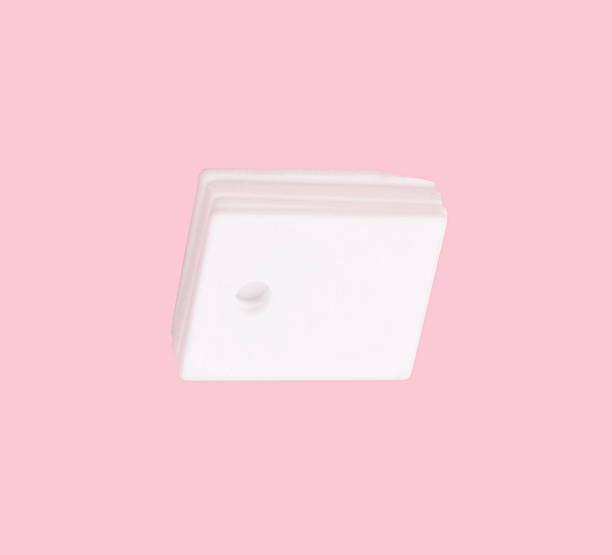 ceramic insulator on isolated Pink Background stock photo