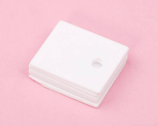 ceramic insulator on Pink Background stock photo