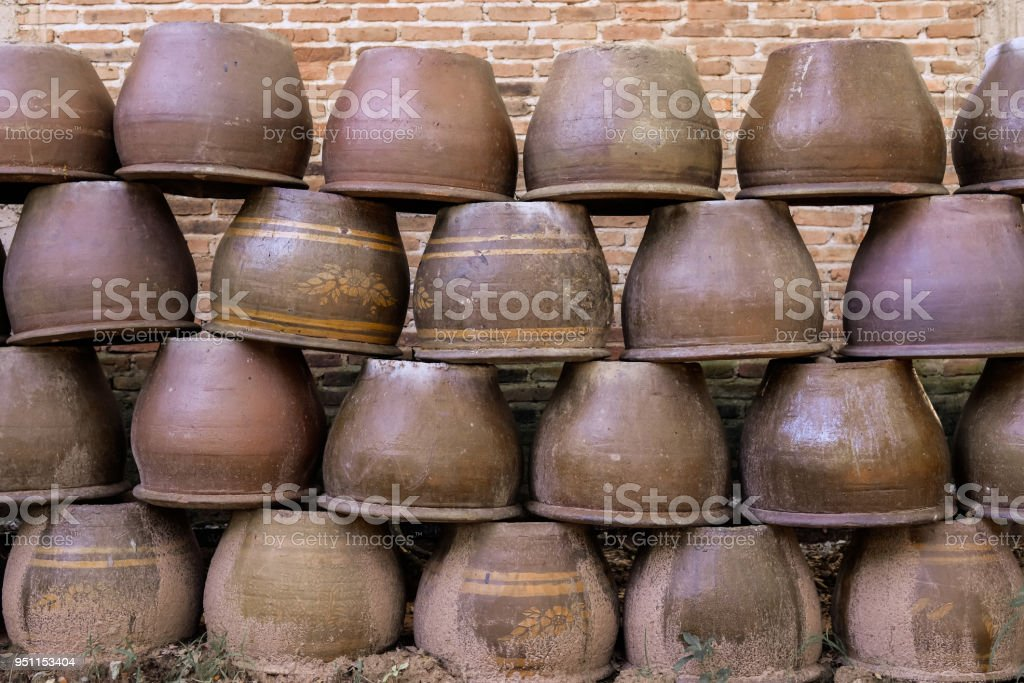 Ceramic jar put overlapping each other on the ground stock photo