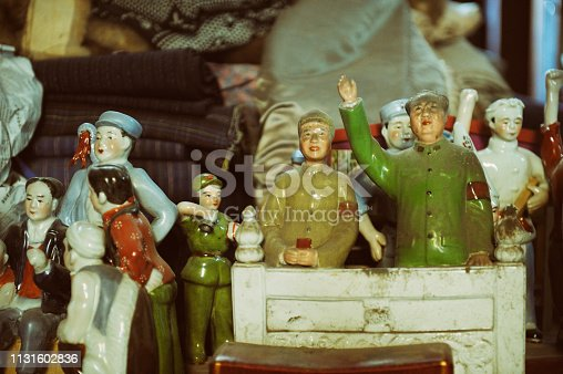 Ancient, dusty, porcelain Chinese propaganda figurines at Shanghai street market.