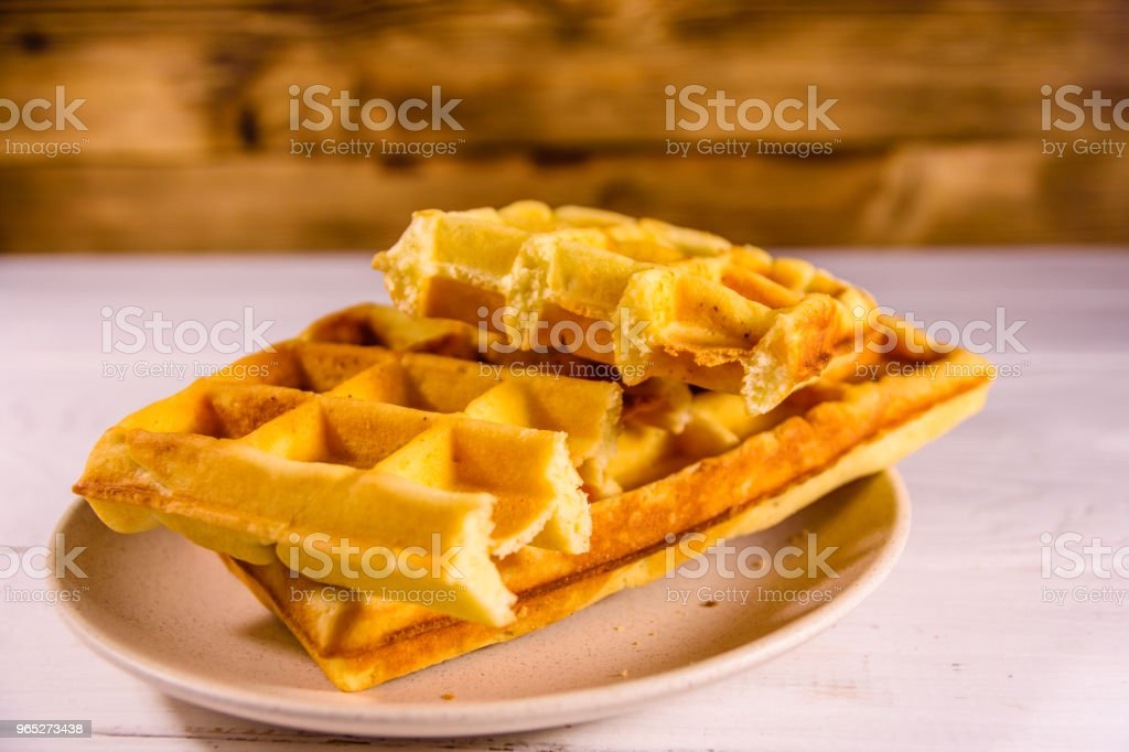 Ceramic plate with belgian waffles on wooden table royalty-free stock photo