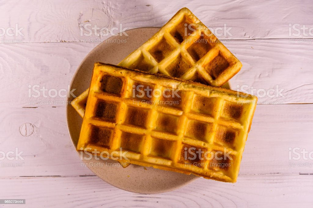 Ceramic plate with belgian waffles on wooden table. Top view zbiór zdjęć royalty-free