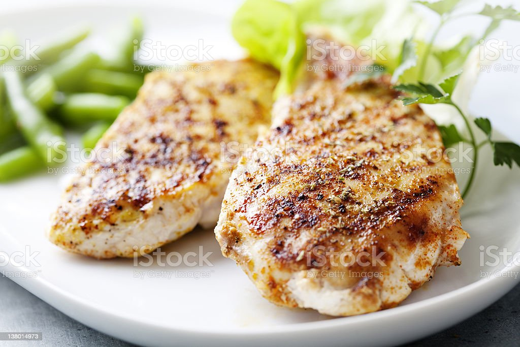 Ceramic plate with grilled chicken breast and green beans stock photo
