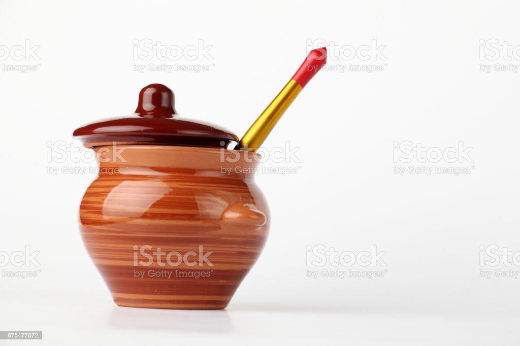 Ceramic pot and spoon. stock photo