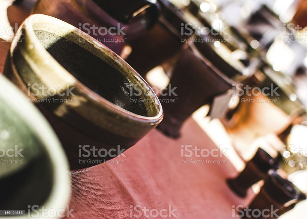 Ceramic pottery on a red cloth stock photo