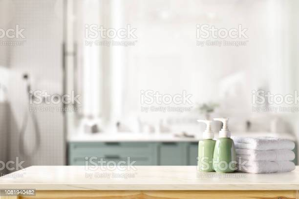 Ceramic shampoo soap bottle and towels on counter over bathroom top picture id1081940482?b=1&k=6&m=1081940482&s=612x612&h=ztyfeyrcnljo4nzy5slijn4flhlnyijdahnr4neeruq=
