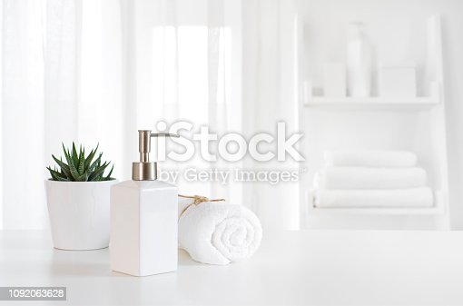 istock Ceramic soap, towel, copy space on blurred white spa background 1092063628