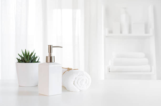 Ceramic soap, towel, copy space on blurred white spa background Ceramic soap, towel, copy space on blurred white spa background bathroom stock pictures, royalty-free photos & images