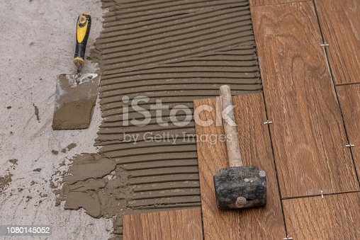istock Ceramic tiles and tools for tiler. Floor tiles installation. 1080145052