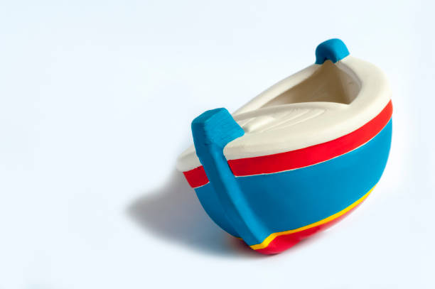 Ceramic Toy Boat tilted to the right stock photo