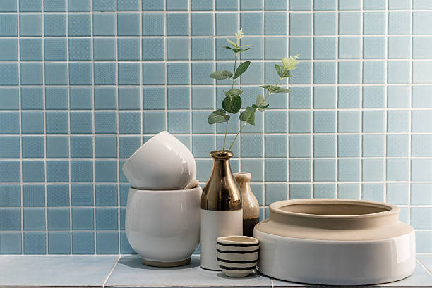 ceramic vase and bowl decoration in a bathroom - 욕실 뉴스 사진 이미지