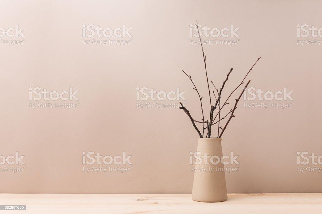 Ceramic vase with decorative branches stock photo