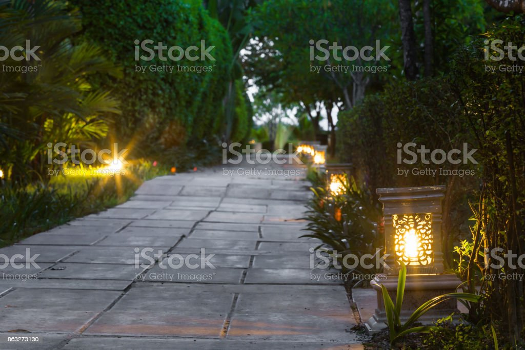 ceramic ware lamp street in the garden walkway at twilight stock photo