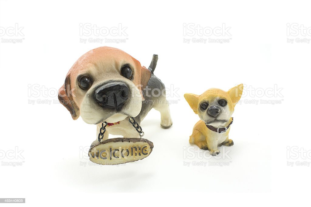 ceramic welcome dogs on white background royalty-free stock photo