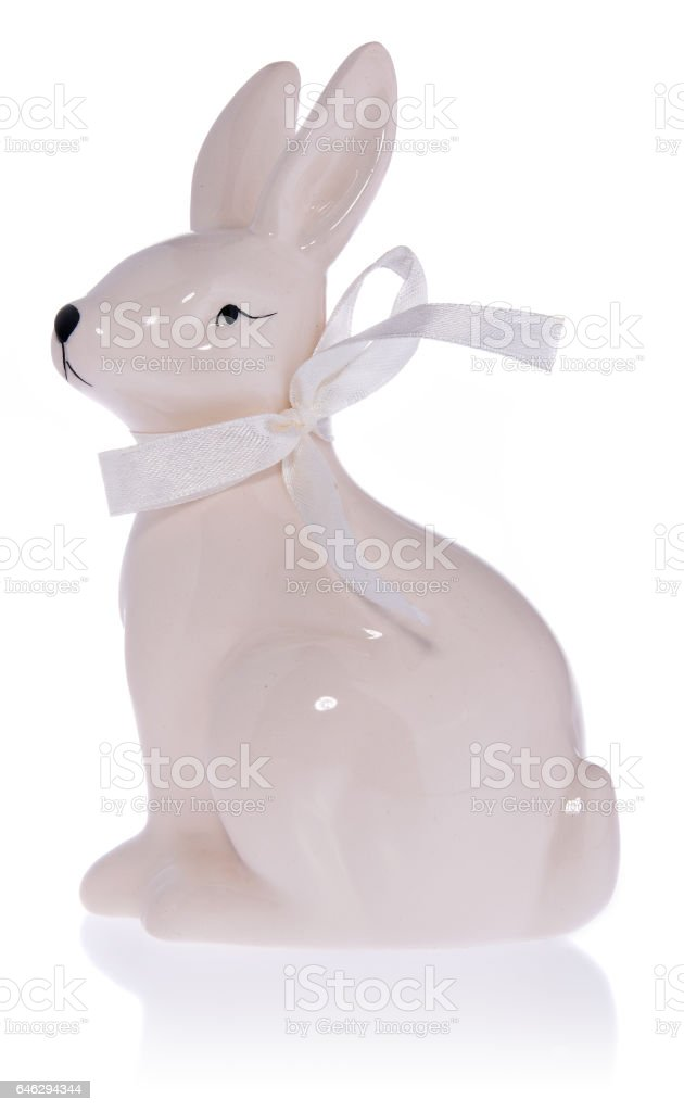 Ceramic white Easter bunny with white bow. stock photo