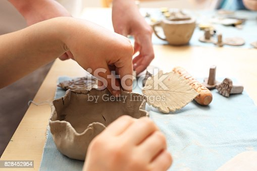 Children clay from the clay in the studio of artistic ceramics